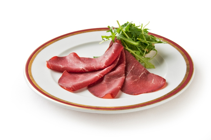 Appetizer of bresaola and arugula